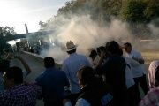 Smoke from tear gas blows in front of protesters near San Pedro Sula, who are demonstrating against new tolls.