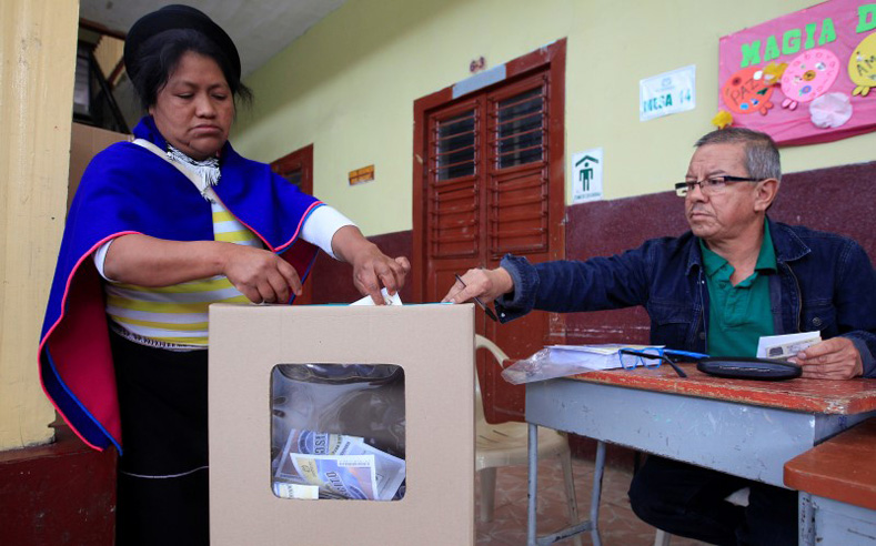 A Colombian Guambiano indigenous woman votes in a referendum on a peace deal between the government and Revolutionary Armed Forces of Colombia (FARC) rebels in Silvia, Colombia, Oct. 2, 2016.