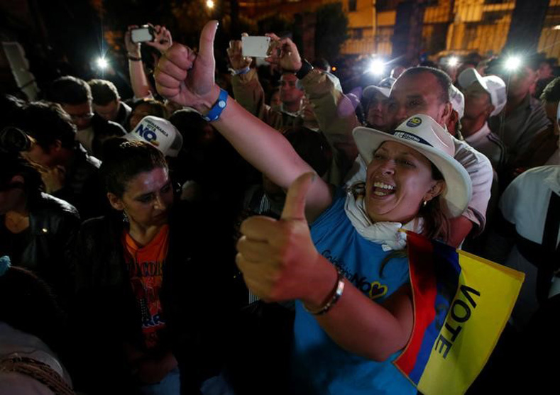 "Supporters of ""No"" vote celebrate after the nation voted ""No"" in a referendum on a peace deal between the government and Revolutionary Armed Forces of Colombia (FARC) rebels, in Bogota, Colombia, Oct. 2, 2016."