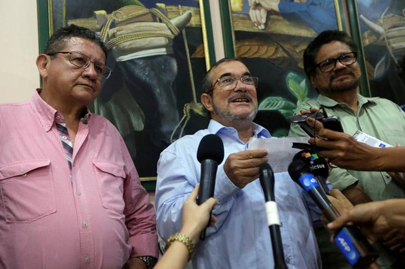 Revolutionary Armed Forces of Colombia (FARC) rebel leader Rodrigo Londono (C) reads from a document while flanked by fellow negotiators Pablo Catatumbo (L), and Ivan Marquez during a conference in Havana, Cuba October 2, 2016