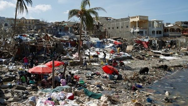 People gather at the shore after Hurricane Matthew passes in Jeremie, Haiti, Oct. 8, 2016.