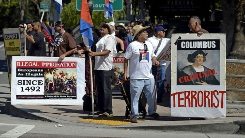 Members  Mexica Movement protest against Columbus Day in downtown Los Angeles, California, Oct. 11, 2015.