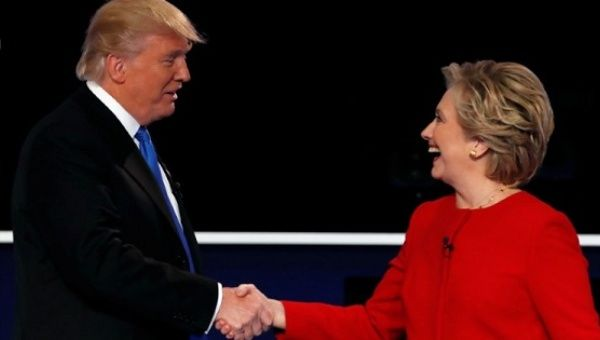 Republican U.S. presidential nominee Donald Trump and Democratic U.S. presidential nominee Hillary Clinton shake hands after a debate.