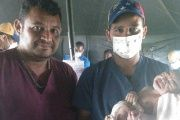 Venezuelan doctors holding the newborn baby in Haiti named 'Venezuela.'