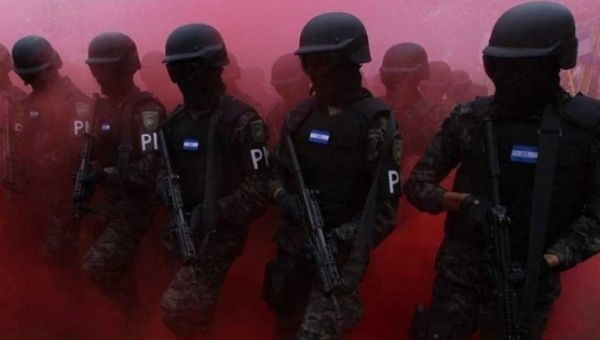 Members of the military police march during a parade commemorating Independence Day of Honduras.