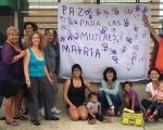 Participants in Proyecto Matria pose with a banner reading