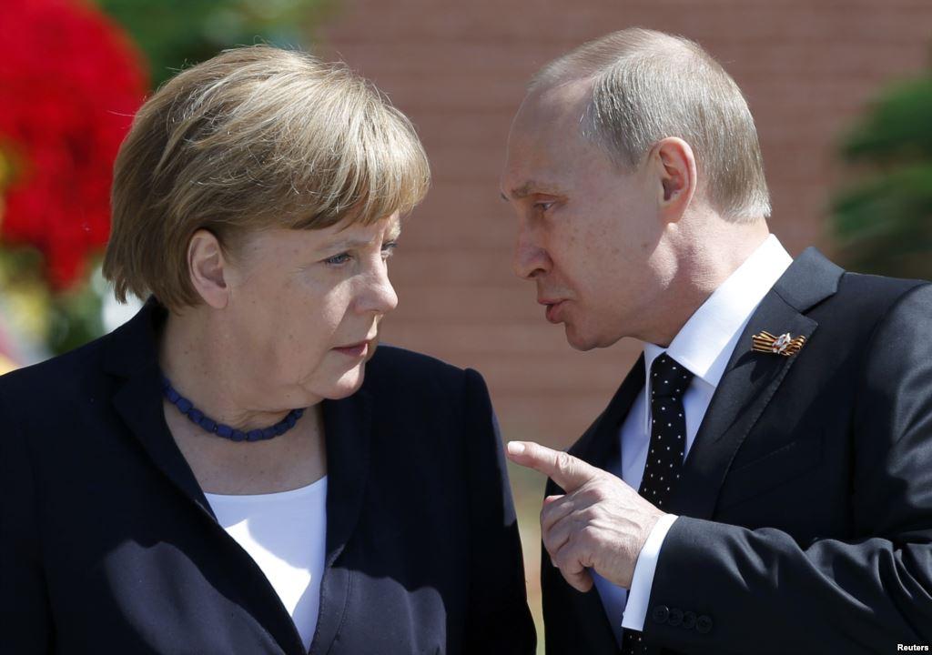 Putin və Merkel müzakirə apardılar