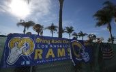 NFL fans Tom Bateman (L) Skye Sverdlin, Daniel Balma, and Joe Ramirez, show their support for the St. Louis Rams NFL team to come to Los Angeles