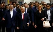 Iranian Foreign Minister Javad Zarif, International Atomic Energy Agency (IAEA) Director General Yukiya Amano and the High Representative of the European Union for Foreign Affairs and Security Policy Federica Mogherini (front L-R) arrive at the United Nations building in Vienna, Austria, January 16, 2016.
