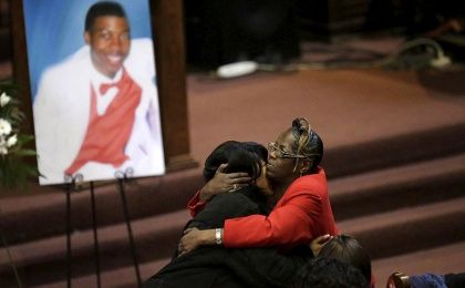 Janet Cooksey (L), is embraced as she attends the funeral for her son Quintonio LeGrier in Chicago, Illinois, January 9, 2016.
