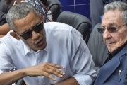 Barack Obama watches baseball with Cuba's Raul Castro.