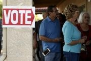 People wait to vote in the U.S. presidential primary election at a polling site in Glendale, Arizona March 22, 2016.
