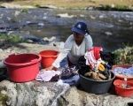 Women wash their clothes at the Acelhuate river in Nejapa, El Salvador, Feb. 23, 2016.