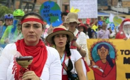 Women activists take part in a march ahead of the 2015 Paris Climate Change Conference, known as the COP21 summit, in Bogota, Colombia November 29, 2015.