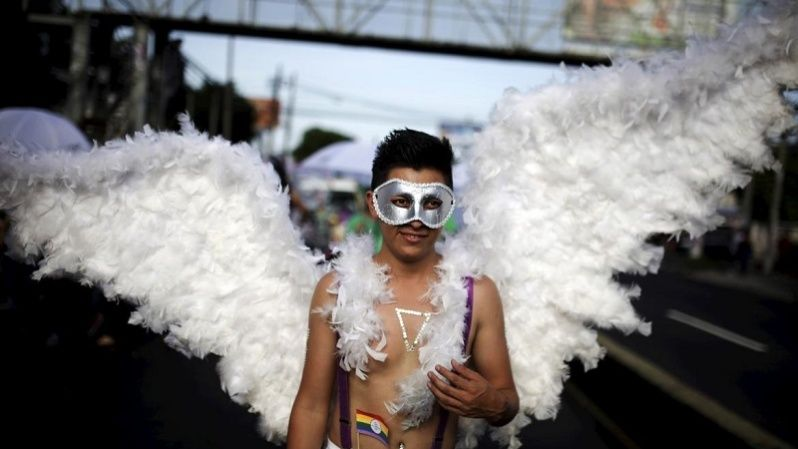 A reveler dressed as an angel takes part in a Gay Pride parade in San Salvador June 27, 2015.