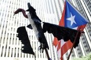 A vulture puppet is held at a protest against Puerto Rico's credit holders as a symbol of the so-called vulture funds.