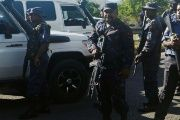 Heavily-armed Papua New Guinea police form a roadblock, preventing students from leaving the University of Papua New Guinea in Port Moresby, Papua New Guinea, June 8, 2016.