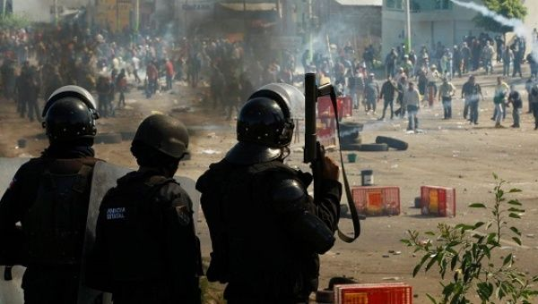 Riot police attack striking teachers in the town of Nochixtlan, in Oaxaca, Mexico, on Sunday.