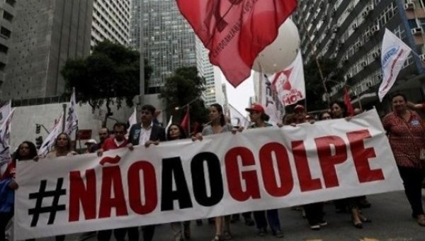 "People with a banner that reads ""No to the coup"" attend a protest against the impeachment proceedings against President Dilma Rousseff, Brazil."