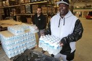 A man picks up bottled water from the Food Bank of Eastern Michigan to deliver to a school after elevated lead levels were found in the city's water in Flint, Michigan.