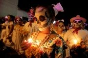 Residents with painted faces, holding candles, participate in The Walk of Souls, during a Day of the Dead festival in Merida, Yucatan, Mexico, Oct. 29,2016.