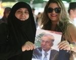 Women carry a picture of newly elected Lebanese President Michel Aoun in the Haret Hreik area, southern suburbs of Beirut, Lebanon, Oct. 31, 2016.