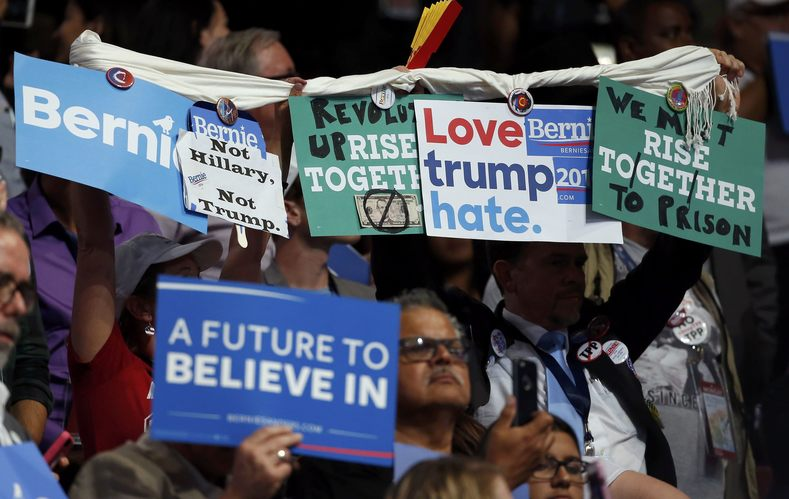 "Echoing a bipartisan grassroots consensus, Bernie Sanders supporters and party dissidents chanted ""Lock Her Up"" on the convention floor in reference to the widely-loathed Democratic presidential candidate Hillary Clinton."