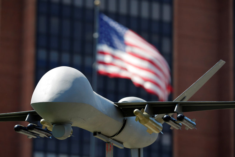 A model of a military drone is seen in front of an U.S. flag as protesters rally against Democratic Party policies, ahead of the Democratic National Convention, in Philadelphia, Pennsylvania, U.S., July 24, 2016.