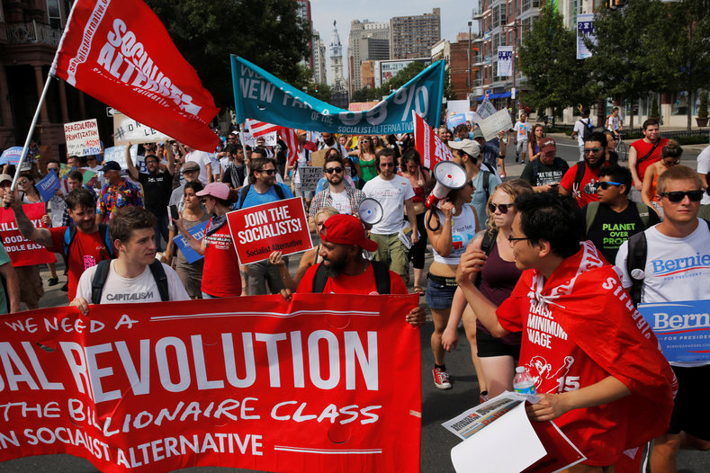 "Socialist Alternative, the organization that spearheaded the campaign to elect Kshama Sawant to Seattle City Council, participated in the protests to ""continue the political revolution and build the socialist movement."""