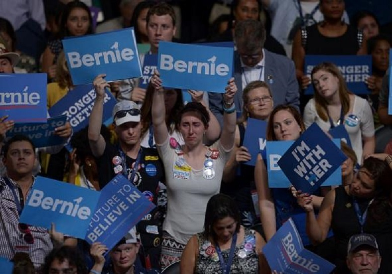 "Inconsolable Bernie Sanders supporters were heartbroken as it appeared that the Vermont senator was putting the brakes on his so-called ""political revolution."""