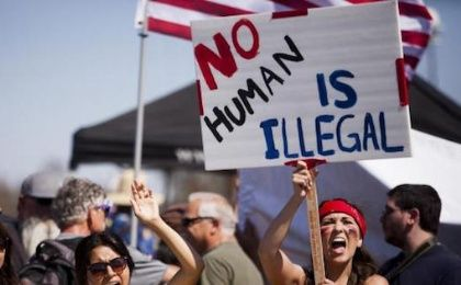 Demonstrators picket before the possible arrival of undocumented migrants who may be processed at the Murrieta Border Patrol Station in Murrieta, California July 4, 2014.