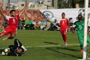 Hebron's Al-Ahly Wael Mresat (L) fails to score against Gaza Strip's Shejaia during the 2015 Palestine Cup final at al-Yarmouk Stadium in Gaza City.