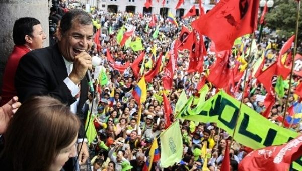 Ecuador President Rafael Correa addresses supporters from the presidential palace in Quito, Ecuador June 15, 2015.