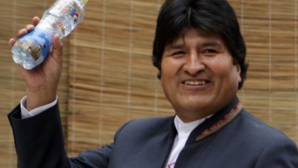 Bolivian President Evo Morales holds a bottle containing water from the Silala stream at a past G77 Summit.