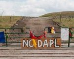 Signs left by protesters sit at the gate of a construction site near the Standing Rock Sioux reservation in North Dakota, U.S., Sept. 6, 2016
