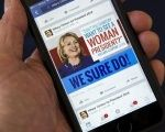 A cell phone shows a Facebook page promoting Hillary Clinton for president in 2016, in this photo illustration taken Apr. 13, 2015.