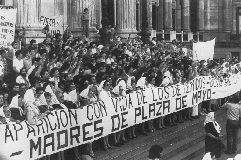 "Members of the ""Madres de Plaza de Mayo"" human rights organization hold a banner demanding information on their missing sons and daughters before marching from the Congress to the Presidential Palace, Oct. 28, 1982."