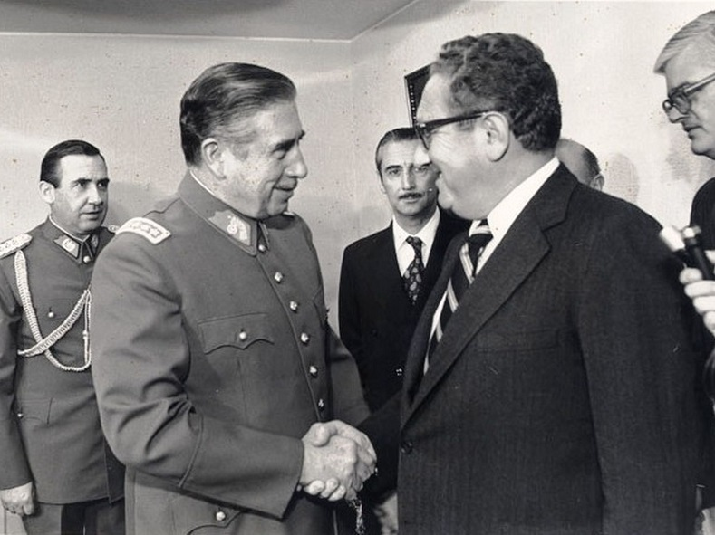 Chilean dictator Augusto Pinochet shaking hands with U.S. Secretary of State Henry Kissinger in 1976. Pinochet