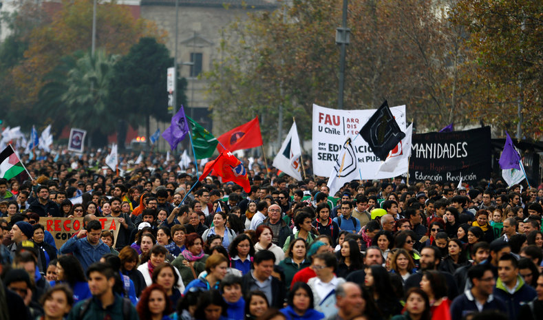 Demonstrators take part in a strike and march, called by Chile