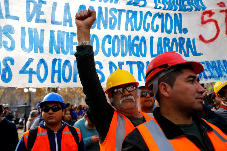 Demonstrators attend a strike and march, called by the Workers