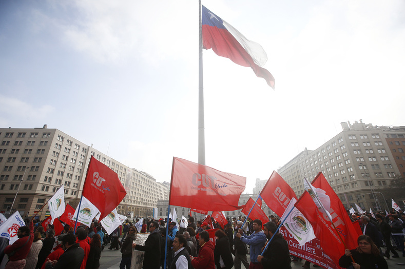 Union banners at the strike and march against government labor reform in Santiago, Chile, May 31, 2016.