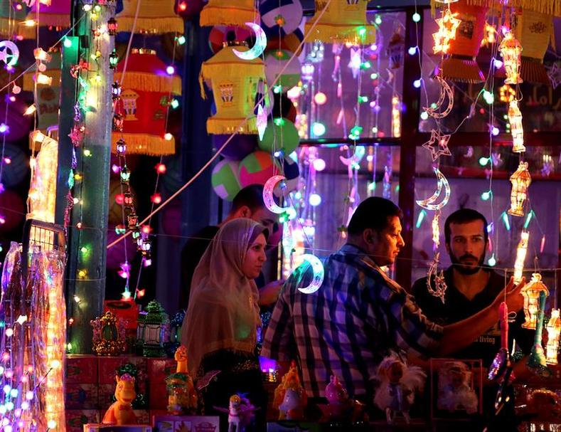 Palestinians buy traditional Ramadan lanterns in celebration the first day of the Muslim holy month of Ramadan at a shop in Gaza City, Gaza Strip, 06 June 2016.