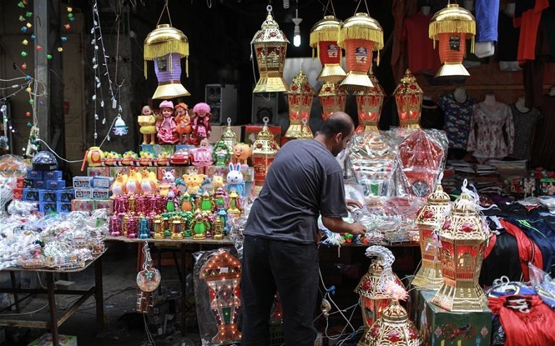 A Palestinian vendor sells traditional Ramadan lanterns in his shop at a market in Gaza City, ahead of the Muslim fasting month of Ramadan, June 5, 2016.