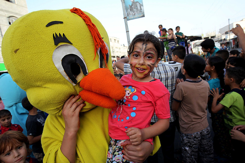 Palestinians take part in a celebration ahead of the beginning of the Muslim holy month of Ramadan in Gaza City