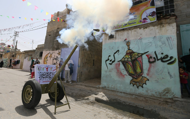 Palestinians test a cannon ahead of the Muslim fasting month of Ramadan in Rafah in the southern of Gaza Strip.