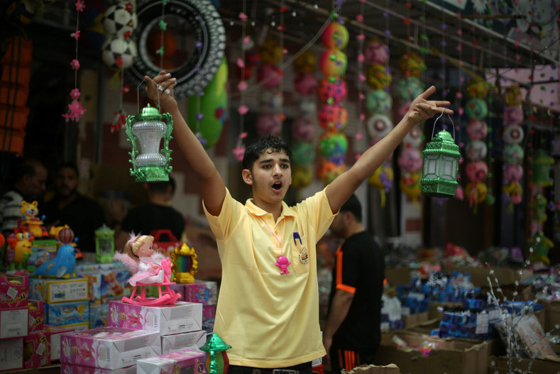 A Palestinian man sells lanterns ahead of the Muslim fasting month of Ramadan in Khan in the southern of Gaza Strip June 5, 2016.
