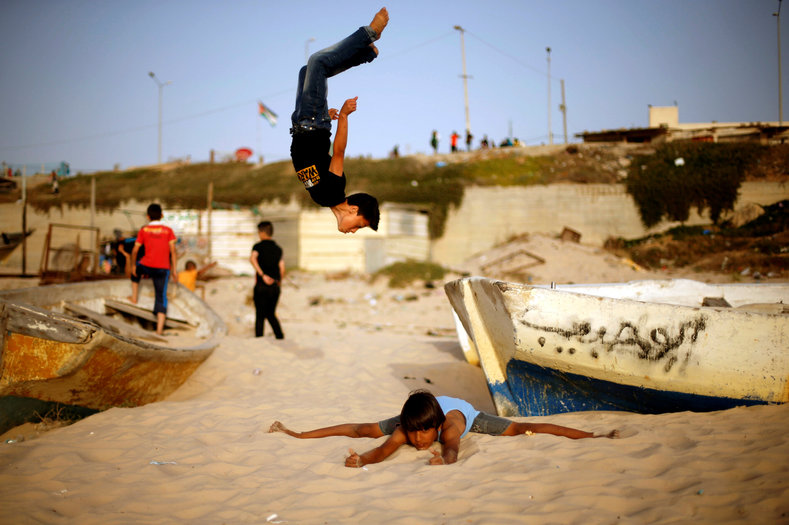 Palestinians enjoy their weekend in the Mediterranean Sea off the coast of Gaza City