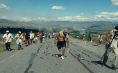 Indigenous People running away from police during Baguazo