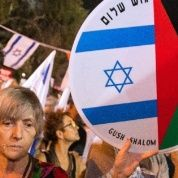 Israeli left-wing activists in Tel Aviv demanded fresh peace talks with Palestinians on the eve of the 20th anniversary of the killing of Prime Minister Yitzhak Rabin.
