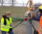 Activists cut chains after trespassing into a valve station for pipelines near Clearbrook, Minnesota, U.S., Oct. 11, 2016.
